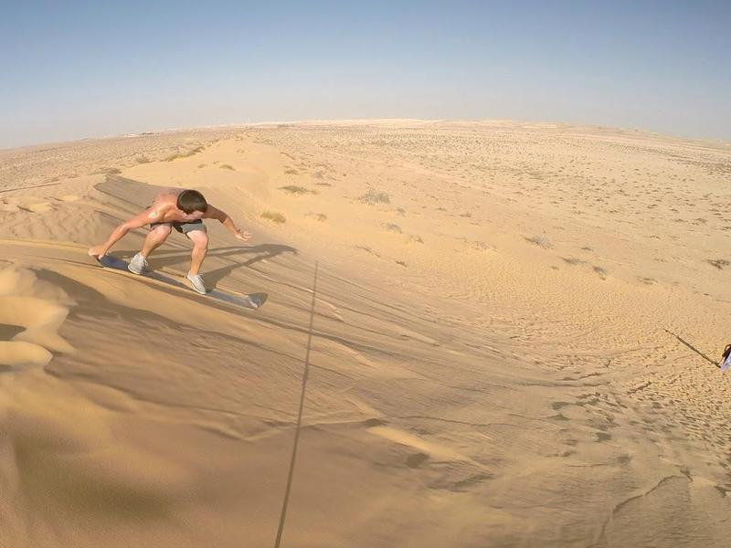 The only thing better than sand-surfing? Sand-surfing with your partner.