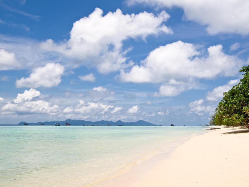 Trang Island has clear waters for prime snorkeling and coral reefs you can stroll to at low tide.