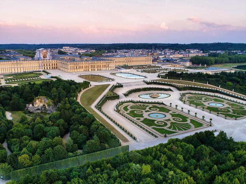 The gardens at Versailles were made in the 17th century for Louis XIV.