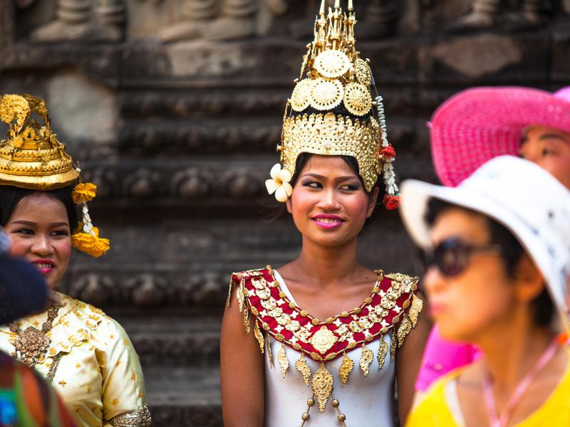Cambodians in gorgeous national dress invite visitors to celebrate the country's artistic spirit.