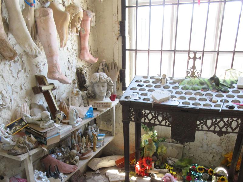 Prosthetic legs are among the offerings at Saint Roch Cemetery.