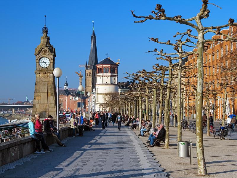 People on the Rhine embankment promenade in Dusseldorf.