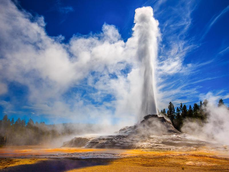 Castle Geyser dramatically erupts in Yellowstone National Park.