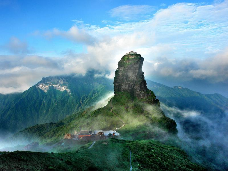 Fanjingshan measures between 1,600 and 8,431 feet above sea level and is blanketed with diverse vegetation.