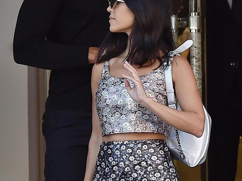 Kourtney Kardashian rocks bold prints in Italy.