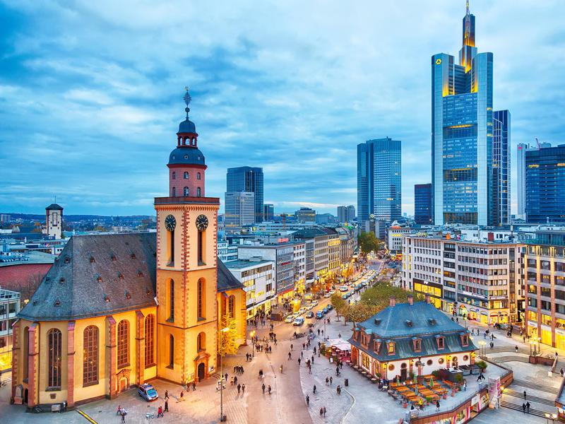 Frankfurt at sunset, with St Paul's Church and the Hauptwache Main Guard building.