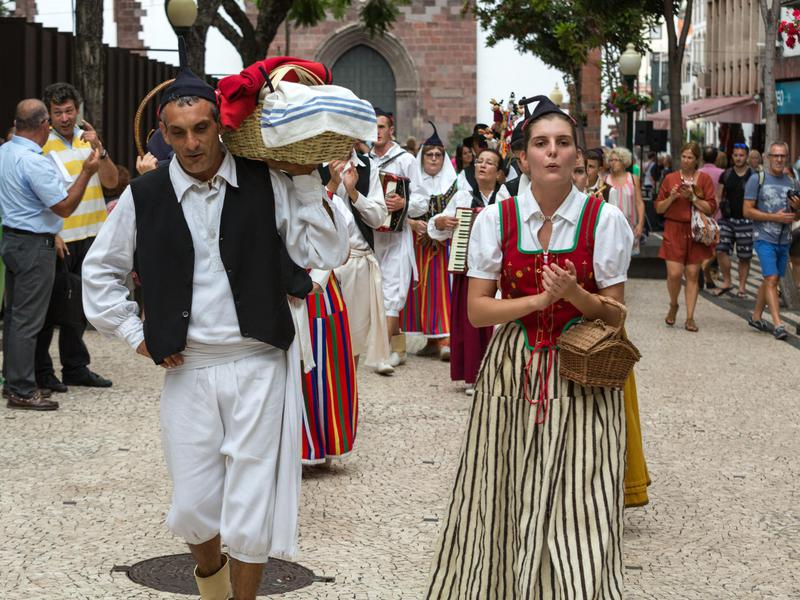 Dancers in local costumes demonstrate a folk dance in Portugal, the world's friendliest country.