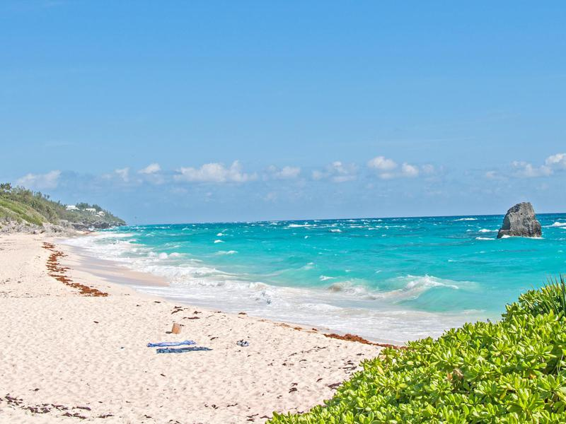 Elbow Beach in Bermuda is quieter alternative to the nearby bustling Horseshoe Bay Beach.