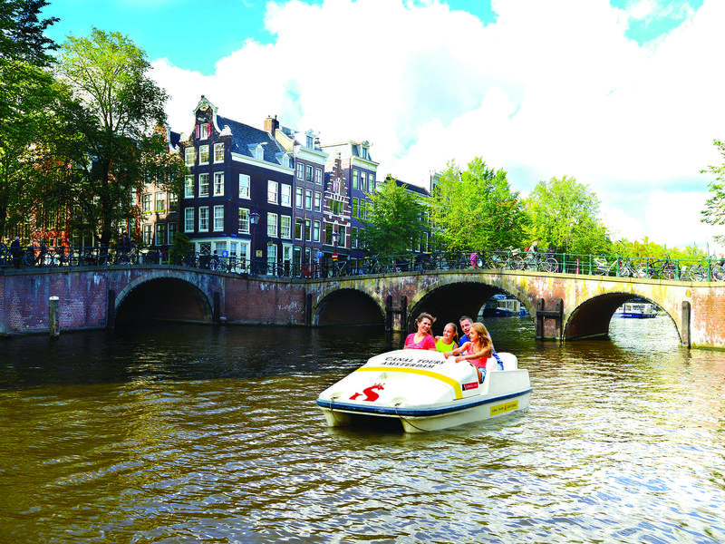 Want to explore Amsterdam's famous canals? Just pedal.