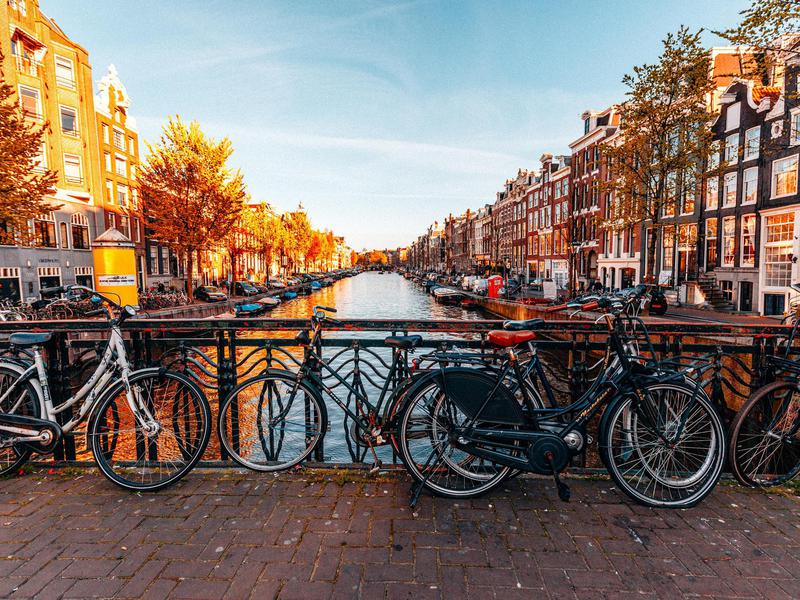 Bicycles parked on a bridge in Amsterdam.
