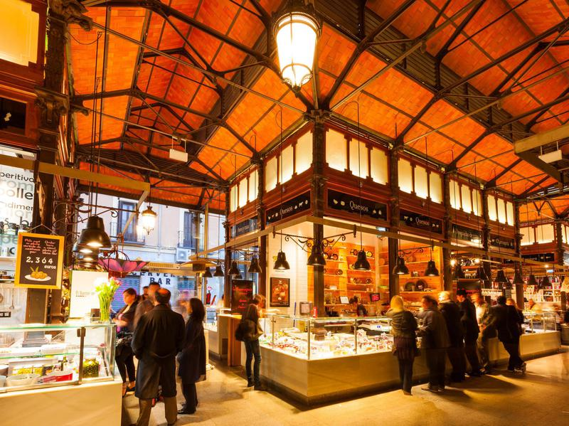 People shopping at San Miguel Market, the last iron market hall in Madrid.