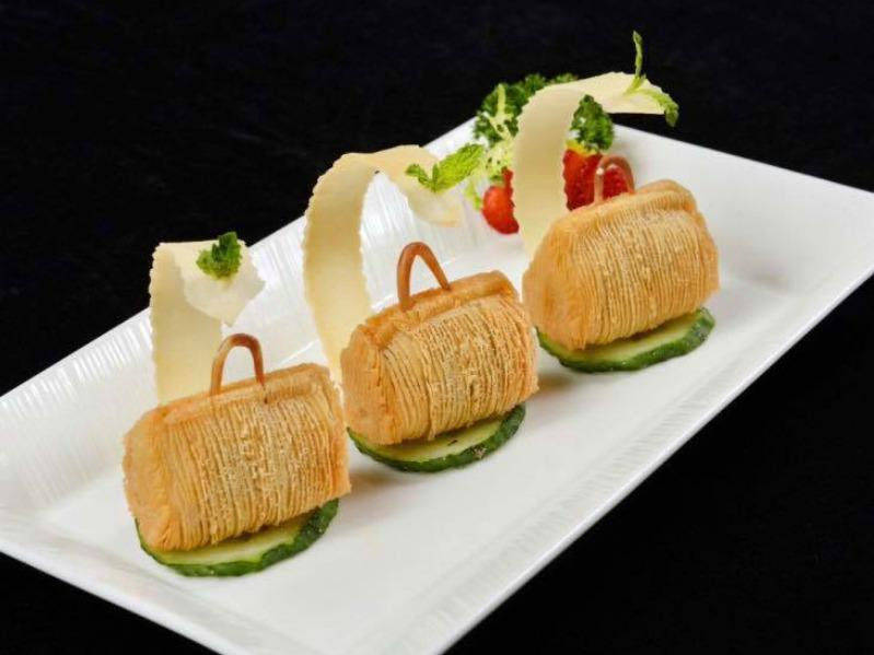 The 8 Restaurant elevates dim sum to creative new heights. Pictured here: puff pastry purses stuffed with river shrimp.