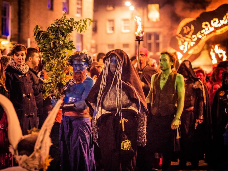 Costumed and painted performers in front of a crowd of thousands during the 2015 Samhain Fire Festival in Edinburgh's Grassmarket.