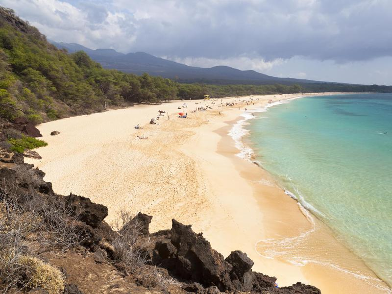 Makena Beach in Maui offers opportunities to sunbathe and body surf with a view of Molokini Crater.