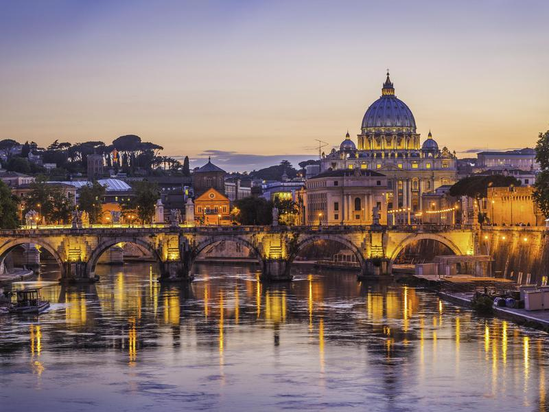 Sunset over St. Peter's Basilica, the heart of tiny Vatican City.