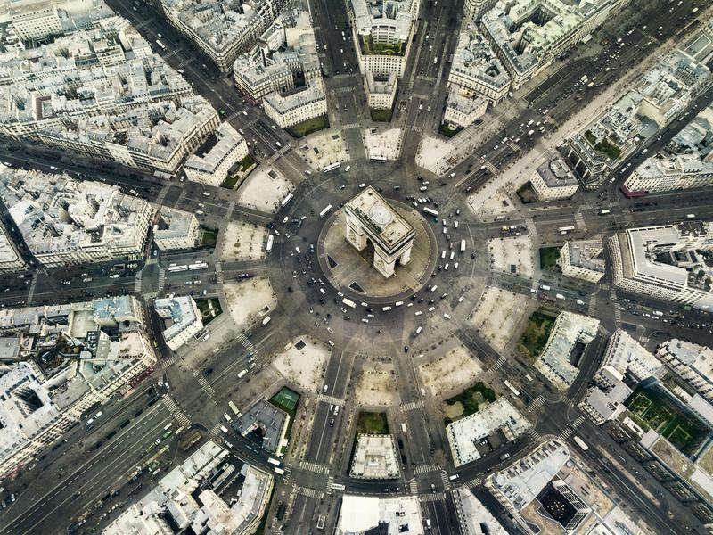 The iconic Arc de Triomphe is the center of activity in Paris.