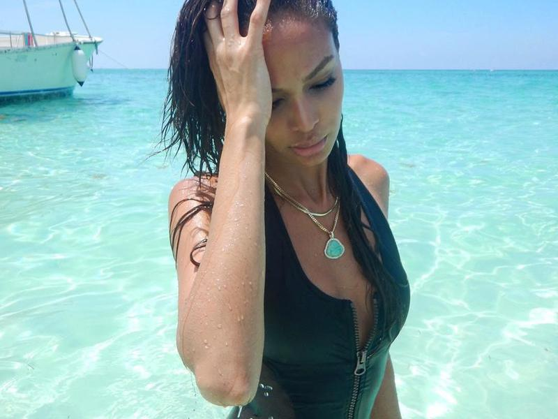 In a swimsuit with a partially unzipped zipper, Joan Smalls brings the heat on Grand Cayman.